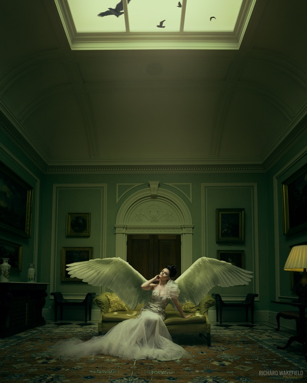 Woman in white dress and wings